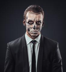 blunt businessman with makeup skeleton