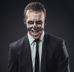 cunning businessman with a makeup of the skeleton