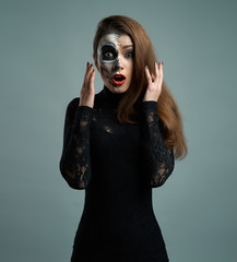 beautiful woman with makeup skeleton dumbfounded