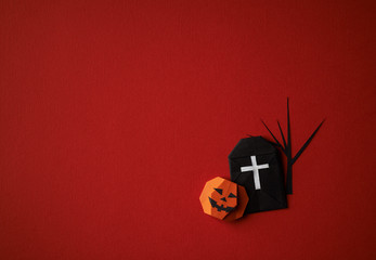 Halloween symbols origami  on a red background