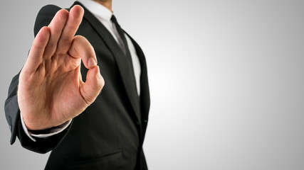 Businessman Showing Okay Hand Gesture