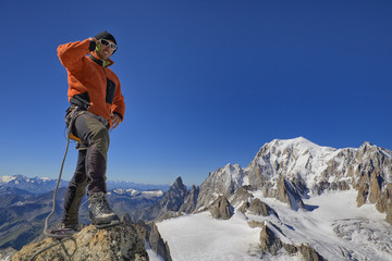 Young mountaineer talking on the phone, copy space