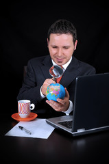 Businessman is searching country on the world