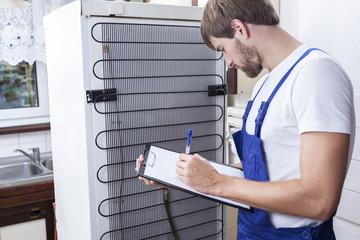 Handyman during fridge repair