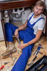 Tired man during sink repair