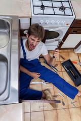 Mad man during rapair in kitchen