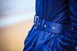 canvas print picture - Female fashion. Closeup blue coat wit belt