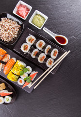 Sushi pieces on black stone