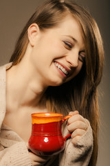 Beverage. Girl holding cup mug of hot drink tea or coffee