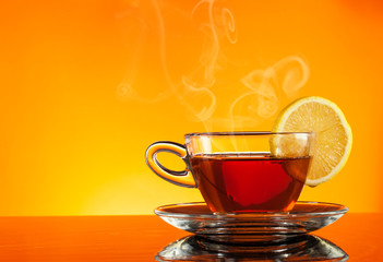Tea in cup with orange background