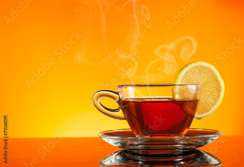 canvas print picture Tea in cup with orange background