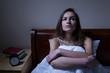 Pensive woman stying sleepless at night