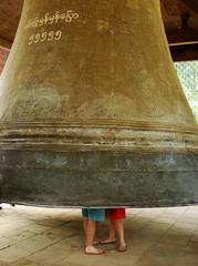 Tourist couple standing inside Mingun bell, Mandalay region, Mya
