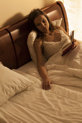 Woman lying in bed, suffering from loneliness