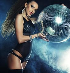 dancer girl in smoke with disco ball