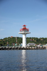 Lighthouse on coastal area.