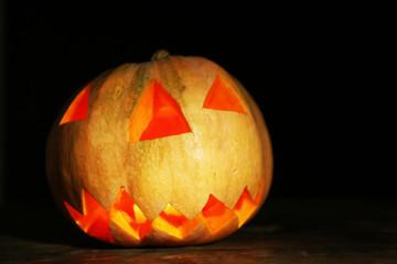 Halloween Pumpkin on wooden table, on dark background