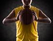 Teenager boy holding a basket ball