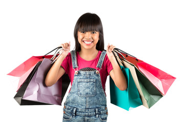 Little asian girl with colorful shopping bags