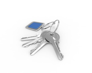 Keys on a key ring with blue pendant on white background
