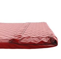 Red bed cover, isolated on white background.