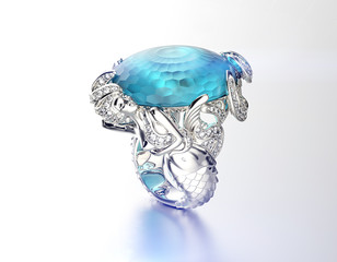 Ring with Blue topaz. Fashion Jewelry background