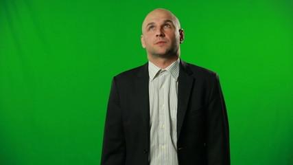 Doubtful businessman on a green background.FULL HD.