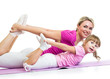 kid girl and mother doing gymnastic on mat isolated on a white