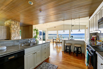 Kitchen area with paneled ceiling and hardwood floor