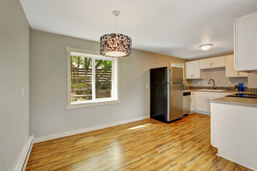 Furnished kitchen room with empty dining area