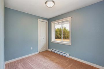 Small light blue bedroom in empty house