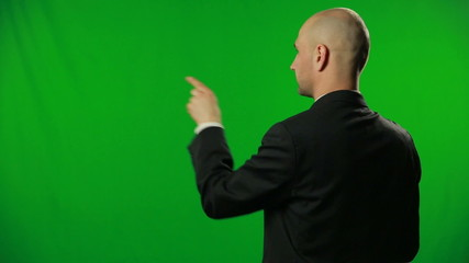 Handsome businessman type smthg on a green screen.FULL HD