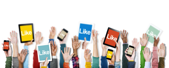 Group of Hands Holding Digital Devices with Like Concept