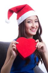 Lovely Asian santa  girl hold gift