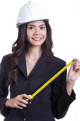 Asian Engineer women hold measure tape
