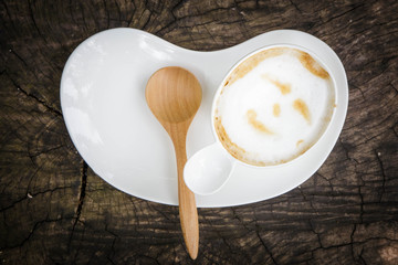 cup of coffee with wood spoon