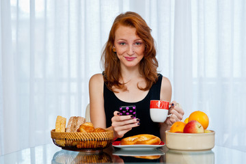 attractive girl with freckles eating breakfast