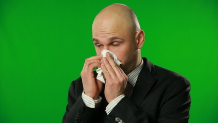 Handsome businessman sneeze, green background. FULL HD