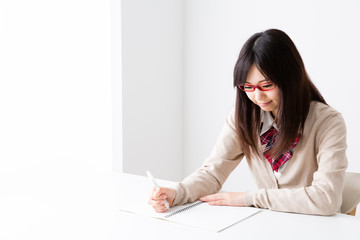 young asian student studying