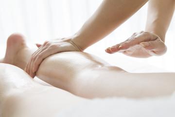 Oil massage of legs