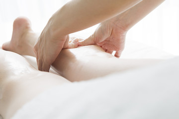 Aromatherapy massage of legs