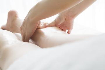 Aromatherapy massage of legs
