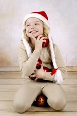 Adorable little girl wearing christmas hat