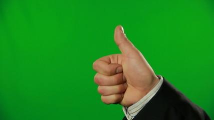 Thumb up on a green screen.FULL HD.