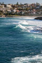 Australia, Bondi Beach surfers riding big waves