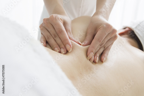 poster of Esthetician pinching the flab on the back