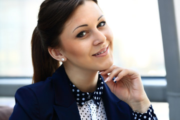 Portrait of a young confident business woman smiling