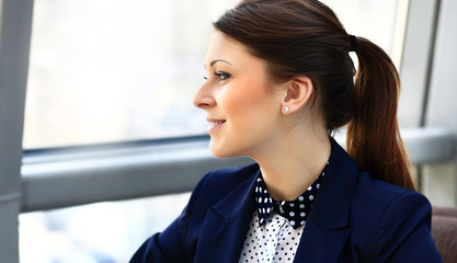 Close-up of a thoughtful young business woman looking away