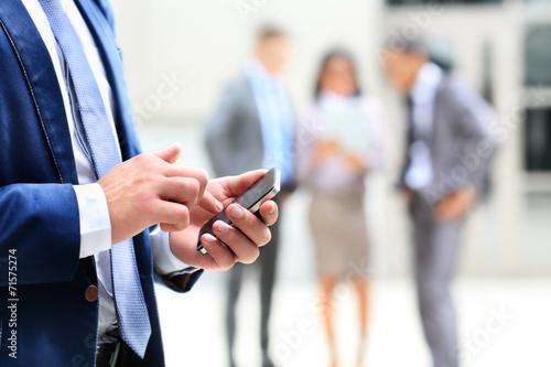 Leinwanddruck Bild Close up of a man using mobile smart phone