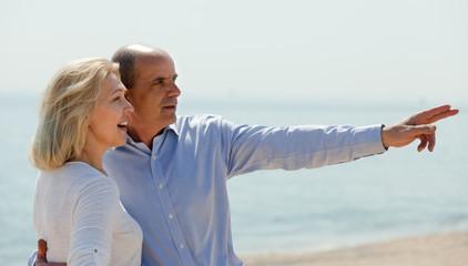 Elderly couple at sea shore